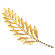 Wonderful gold tone Fern pin with Aurora Borealis rhinestones brooch