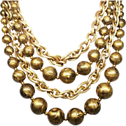 Wonderful gold tone chain and bead multi strand necklace