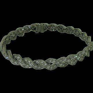 Divine Platinum and Diamond Swirl Bracelet
