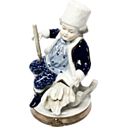 Charming Unterweissbach Seated Young Man Figurine