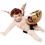 Charming Volkstedt Reclining Putti With Flowers Basket Figurine