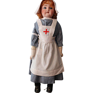 JDK 154 Antique doll in replica of early nurses costume-24 inch-excellent body and head