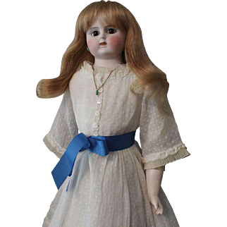 Alt,  Beck, Gottschalck doll;  leather body with bisque lower arms; bisque dome head; blonde wig; brown eyes; 21.5 inches