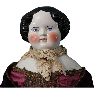China Head doll, 28 inches, fancy velvet and gold trimmed outfit/head is perfect/limbs have no issues