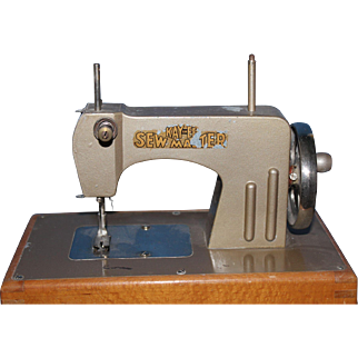 Child's sewing machine - Kay an EE-SewMaster -  probably 1940's or 1950's/Metal with oak wood base