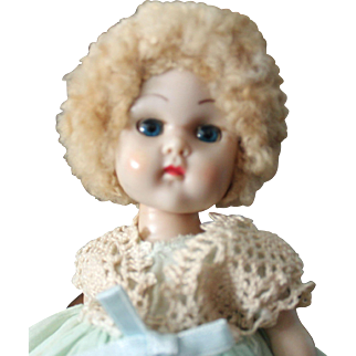 Ginny doll in caracul wig - 1950's in good condition with tagged dress