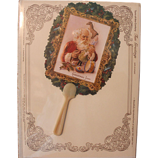 Reproduction Christmas fan for doll venue...features Santa in his work shop