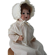 "Armand Marsaille baby doll 975-approximately 18 inches with sleep eyes and 14"" diam. head"