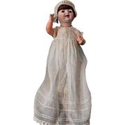 "Hertel, Schwab and Company-11"" antique German baby doll-orig. body paint-mohair wig-with excellent bisque head. Sleep brown glass eyes."