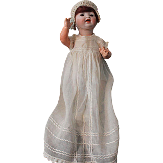 """Hertel, Schwab and Company-11"""" antique German baby doll-orig. body paint-mohair wig-with excellent bisque head. Sleep brown glass eyes."""