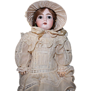 """Kestner """"C"""" doll, 17 inches; antique costume, HH wig, composition body with some repairs"""