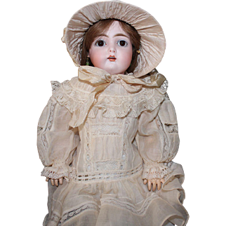 "Kestner ""C"" doll, 17 inches; antique costume, HH wig, composition body with some repairs"