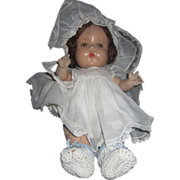 Very old Horsman composition baby doll with tin eyes and ridiculous bonnet