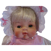 Vintage adorable baby doll in pink gingham cloth body vinyl head limbs crisp and clean