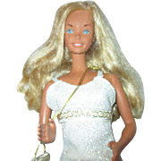 Supersized Barbie in Metail chain dress with fish net stockings 1970's