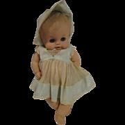 "Absolutely adorable Sun Rubber baby doll  13"" original era clothing"