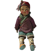 Antique composition and cloth Asian  baby doll with painted eyes original outfit