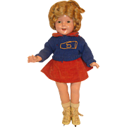 Vintage Shirley Temple doll in old ice skating shoes sweater and skirt IDEAL doll company all composition.