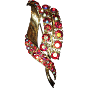 Vintage Unmarked Red Aurora Borealis rhinestone and gold-toned metal brooch pin retro era