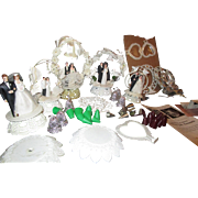 Various grouping of Wedding Cake toppers and cake decorating items