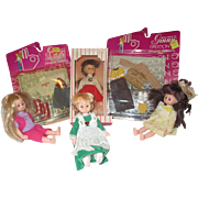 4 Vogue Ginny dolls, one in box, with outfits.
