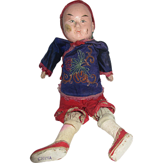 Vintage Chinese doll with composition face and bisque feet made in China Asian theme