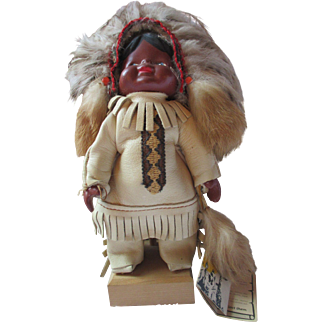 Vintage French Canadian Native American Souvenir doll with tags bisque composition on stand Quebec