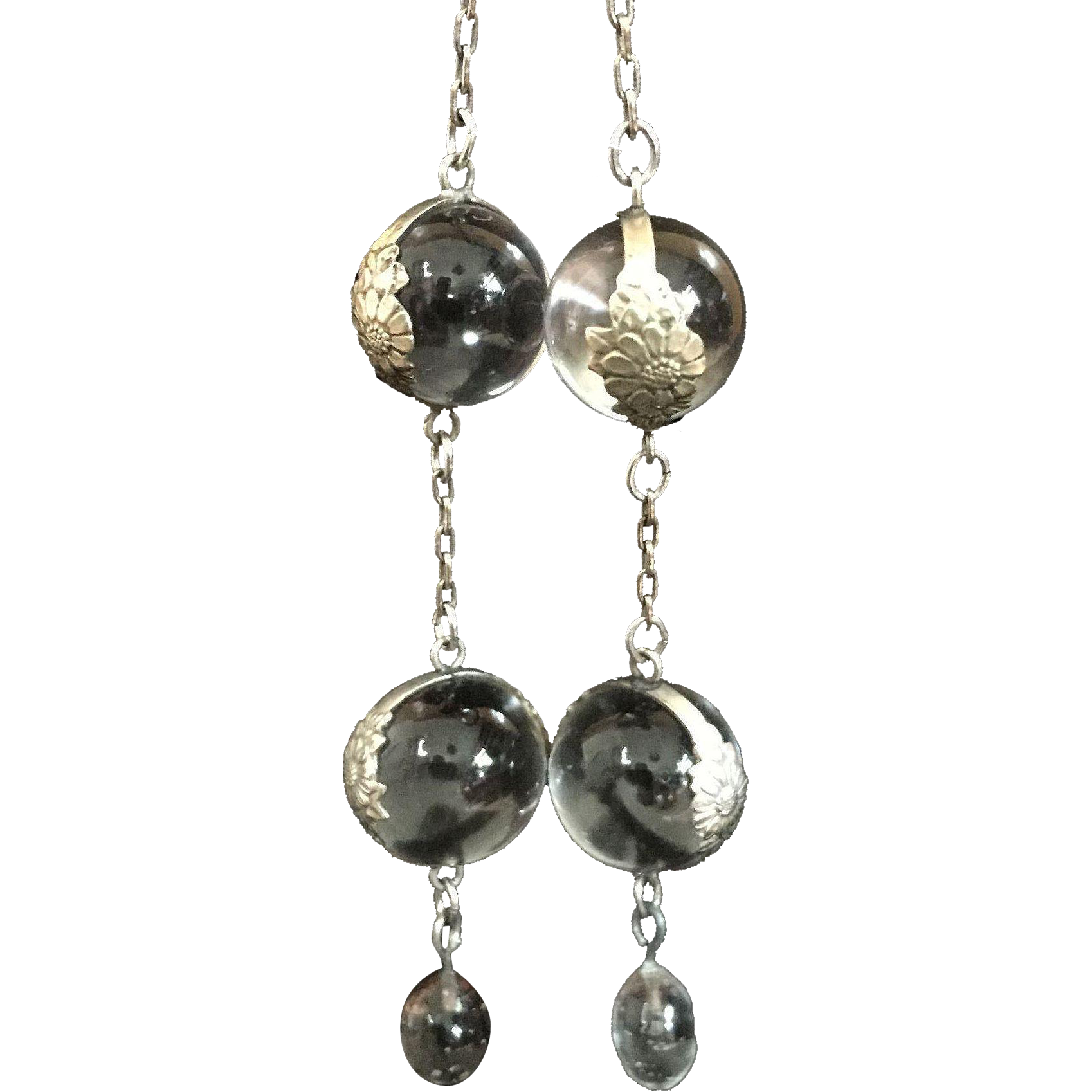 Double orb rock crystal pools of light earrings.
