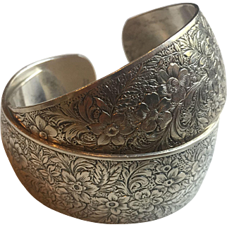 Stunning pair of Danecraft Sterling silver floral cuff, bracelets.