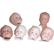 Six bisque baby- doll heads:  hand painted-Germany