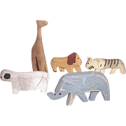 This is a very nice selection of wooden carved animals..