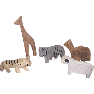 These are the remainder of the carved animal set that i have...the giraffe needs a bit of shaving to stand up straight,but that should be very easy to do..
