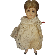 "4 1/2"" All Bisque Doll House Child with Glass Eyes and Swivel Head"