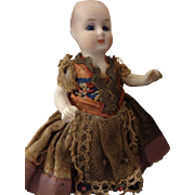 Miniature All Bisque Doll with Glass Eyes and Original Costume