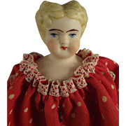 Bisque Girl with Blonde Sculpted Hair and Polka Dot Dress