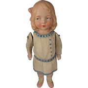 All Bisque Side Glancing Girl with Molded Clothes and Bow in Hair