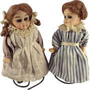 Pair of German All Bisque Sisters with Glass Eyes and Swivel Heads