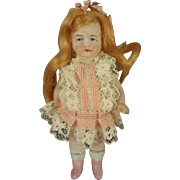 "3 1/2"" All Bisque Doll with Red Flowing Wig"