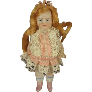 """3 1/2"""" All Bisque Doll with Red Flowing Wig"""
