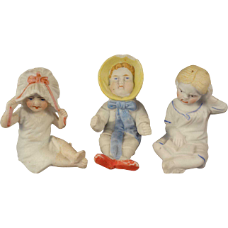 Three Seated Bisque Figures