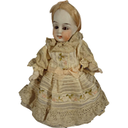 "Adorable 4 1/2"" All Bisque Doll with Swivel Head and Glass Eyes"