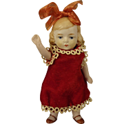 "4 1/2"" All Bisque Doll with Jointed Limbs and Bow in Hair"