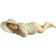 Bisque Reclining Baby with a Bonnet