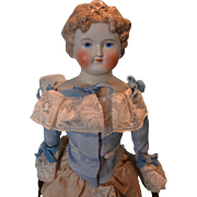 Parian Bisque Doll with Fancy Molded Hair and Leather arms