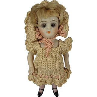 All Bisque Girl with Glass Eyes Pink Textured Socks and Mohair Wig