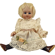"5"" All Bisque Doll with Swivel Head Sleep Eyes and Black Stockings"