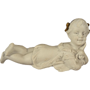 Reclining All Bisque Girl Holding a Doll