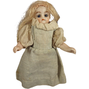 All Bisque Doll with Swivel Neck Glass Eyes and Yellow Boots