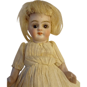 "5"" All Bisque Doll with Swivel Head Glass Eyes and Blonde Wig"