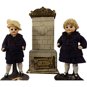 Pair of Delightful All Bisque Boy and Girl Dressed in Winter Coats